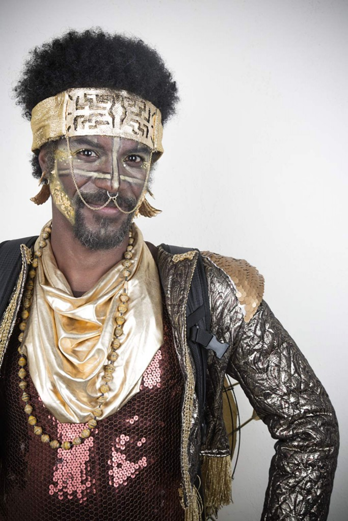 Man in costume with gold headband