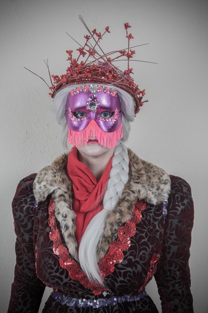 Woman in costume with pink mask