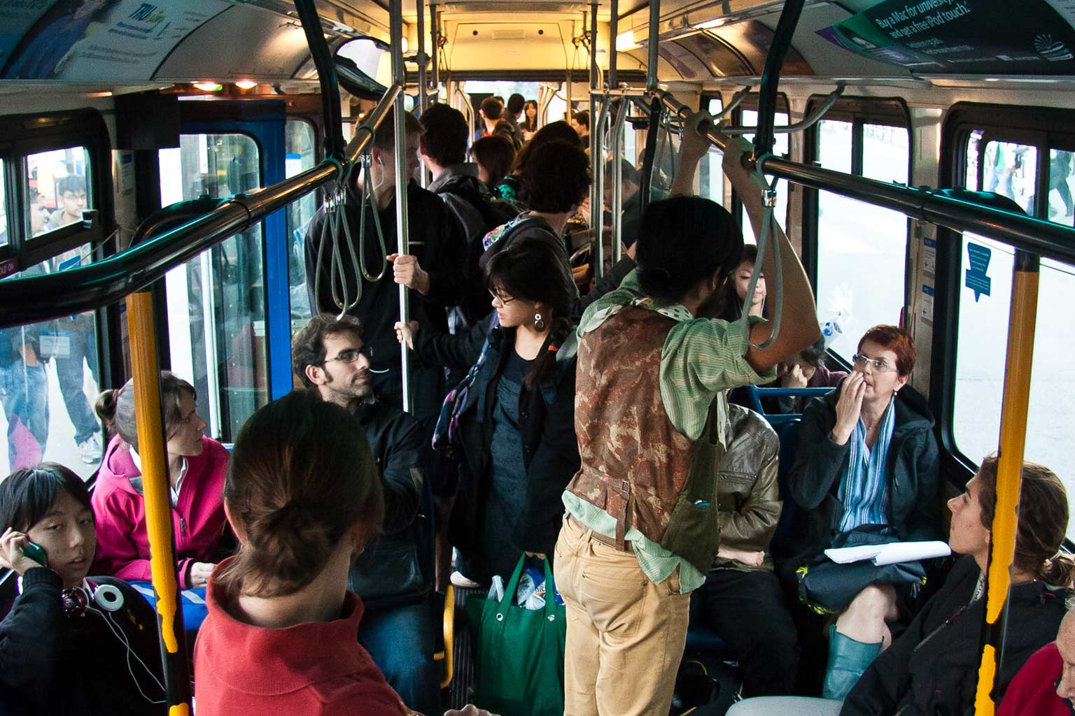 people riding the bus