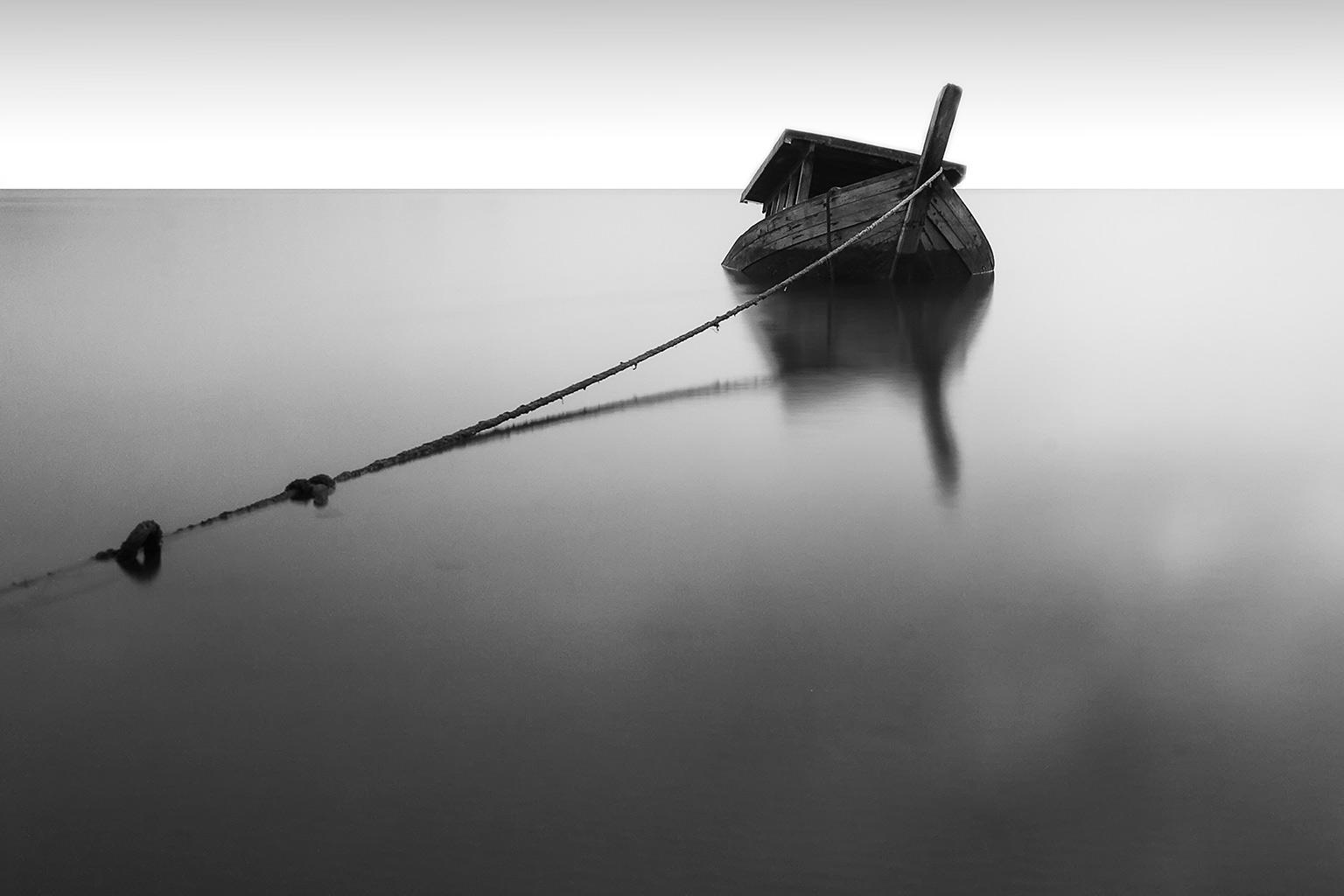 half-sunken boat at sea