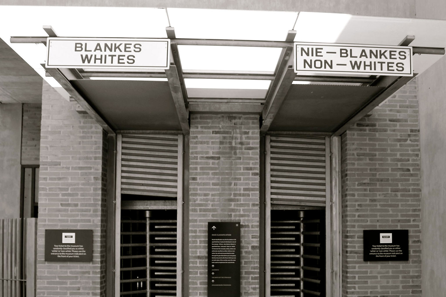 signage for whites vs. non-whites outside building