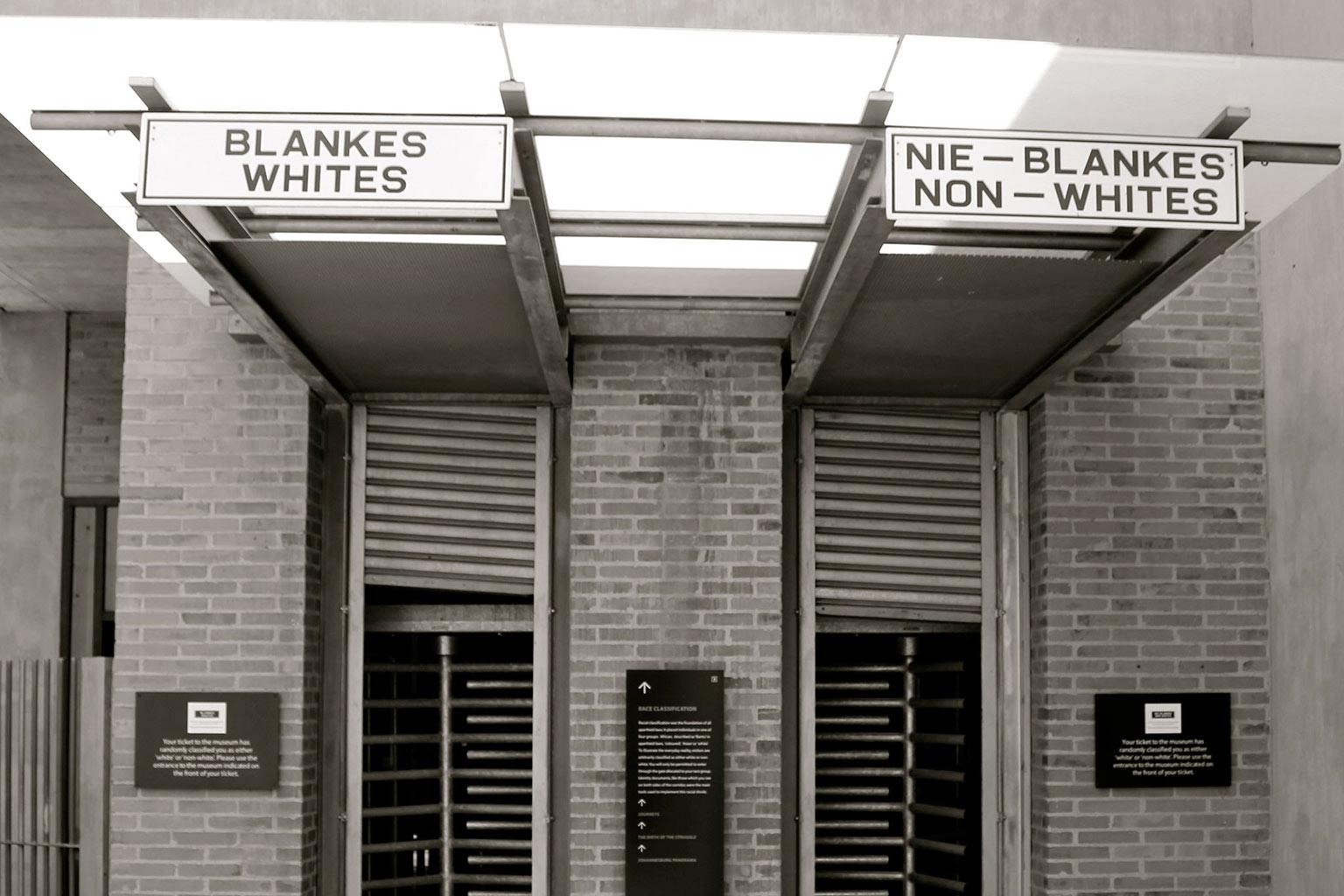 signage for whites vs. non-whites outside building